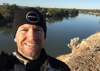 Rodney Brown standing on the banks for the Murray River near Morgan.